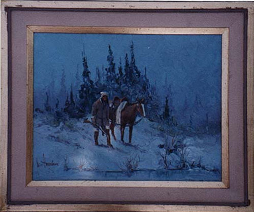 A picture of a man and his horse out late in the snowy woods.